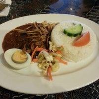Photo taken at Mutiara Malaysian Restaurant by Brian Y. on 7/2/2013