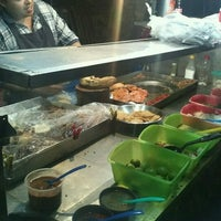 Photo taken at Tacos Los Primos by Mariano C. on 10/28/2012