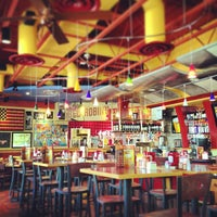 Photo taken at Red Robin Gourmet Burgers by t r. on 7/17/2013