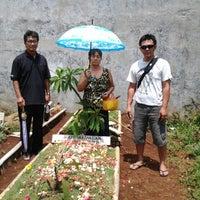 Photo taken at Tempat Pemakaman Umum Kalimulya I by Meilyna N. on 12/7/2013