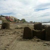 Photo taken at Playa El Candado by Rafa E. on 9/29/2013