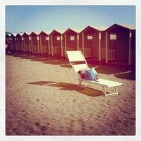 Photo taken at Corallo beach by Linouita L. on 10/20/2012