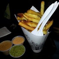 Photo taken at Pommes Frites by Keri D. on 5/4/2013