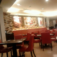 Photo taken at Kenny Rogers Roasters by Azril A. on 4/21/2013