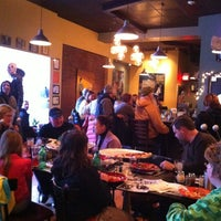 Photo taken at Flying Saucer Pizza Company by Caitlin f. on 3/16/2013