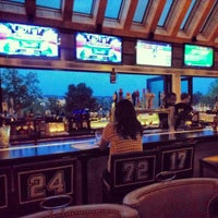 Photo taken at Champs Sports Grill by Joey L. on 6/7/2013