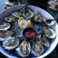 Photo taken at Poppy's Crazy Lobster Bar & Grill by Matt M. on 3/6/2013