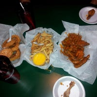 Photo taken at Sports Grill by Kayla R. on 12/28/2012