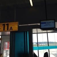 Photo taken at Gate 11a by Giuseppe Z. on 12/17/2013
