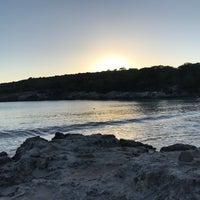 Photo taken at Cala Turqueta by Sandra S. on 1/6/2017