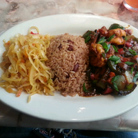 Photo taken at Caribbean Feast Cuisine by Phillysdon04 D. on 4/7/2013