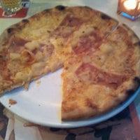 Photo taken at Pizzaria Pavarotti by Emiel B. on 10/12/2012
