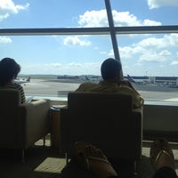 Photo taken at Delta Sky Club by Erin P. on 7/14/2013