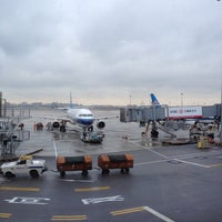 Photo taken at Gate 73 by F Y. on 12/2/2012