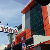 Photo taken at Toserba YOGYA by Novita T. on 12/26/2014