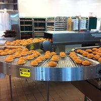Photo taken at Krispy Kreme Doughnuts by Paul on 5/18/2013