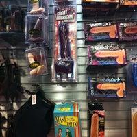 Photo taken at Hustler Hollywood by Jon T. on 12/9/2012