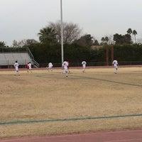 Photo taken at Marcos de Niza Football Field by Rudy R. on 1/24/2014