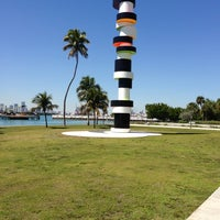 Photo taken at South Pointe Park by Omar O. on 3/7/2013
