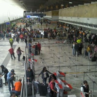Photo taken at Gate 6 - Aeropuerto El Dorado by Valneide M. on 5/19/2012