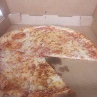Photo taken at Basil's Pizza by Derek S. on 4/1/2016
