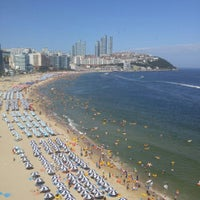 Photo taken at Haeundae Beach by Chang W. L. on 7/26/2015