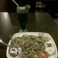 Photo taken at Kayu Manis Resto by Dania Nurhasani P. on 11/15/2012