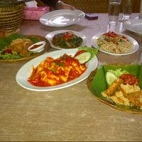 Photo taken at RM. Saung Desa by Fidelia M. on 10/2/2012