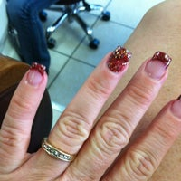Photo taken at Famous Nails by Rhonda on 12/16/2012