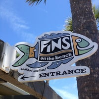 Photo taken at Fins On The Beach by Matthew B. on 5/25/2013