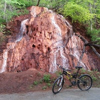 Photo taken at The Red Waterfall by Peter B. on 5/9/2013