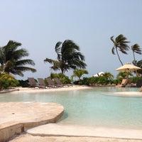 Photo taken at Coco Beach Resort by Krista H. on 4/18/2013