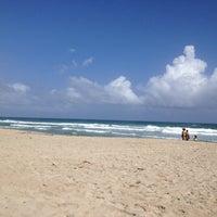 Photo taken at Playa Parguito by Mireia M. on 12/30/2012