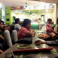 Photo taken at Nice's Coffee Station by Jaharaini J. on 9/29/2012