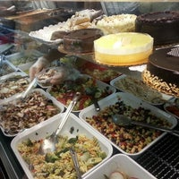 Photo taken at Nica's Market by Pete C. on 6/1/2014