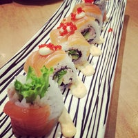 Photo taken at Sushi Zanmai by Germaine W. on 1/10/2013