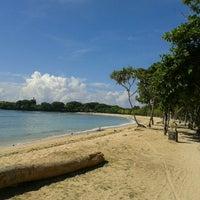 Photo taken at Nusa Dua Beach by Iqbal H. on 4/23/2013