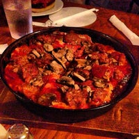 Photo taken at Pequod's Pizzeria by Cal Q. on 4/23/2013