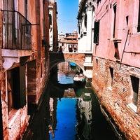 Photo taken at Ponte Della Scuola by Lorenzo C. on 7/19/2014