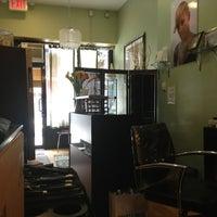 Photo taken at Slique Hair Studio by Balhomee C. on 3/28/2013