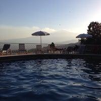 Photo taken at Mediterranee Hotel Taormina by Andrea B. on 8/21/2016