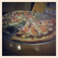 Photo taken at Gusto Pizza Co. by Lizzy S. on 1/11/2013