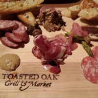 Photo taken at Toasted Oak Grill & Market by R T. on 2/6/2014