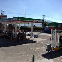 Photo taken at Gasolinera Angamacutiro by Alejandro F. on 2/12/2014