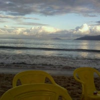 Photo taken at Praia Martim de Sá by Vivi R. on 11/17/2012