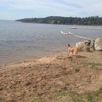 Photo taken at Burt Dog Beach by Heather C. on 5/8/2013