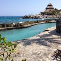 Photo taken at Playa Xcaret by Svetlana G. on 4/23/2013