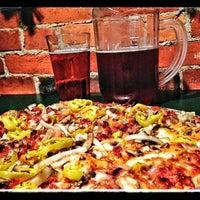 Photo taken at Hounddog's Three Degree Pizza by Tasha L. on 1/28/2013