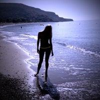Photo taken at Pissouri Beach by Lina K. on 6/12/2013