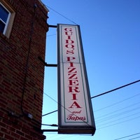 Photo taken at Guido's Pizzeria & Tapas by Erik R. on 12/1/2013